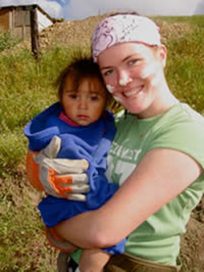 Volunteer holding a child